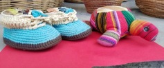 These hand-crocheted booties are the size of a 6-8 month old baby. The toy turtle is hand sewn and stuffed with cotton