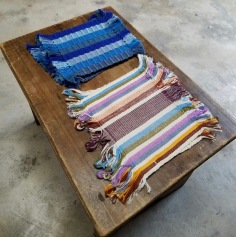 This set of cloth coasters come in a set of six- 3 blue and 3 multi color. They are handmade from the cotton locally grown in San Juan and dyed with natural colors