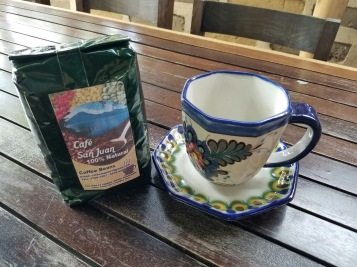 This mug and saucer are hand-painted and comes with 1 pound of local San Juan coffee (either whole beans or grounds)